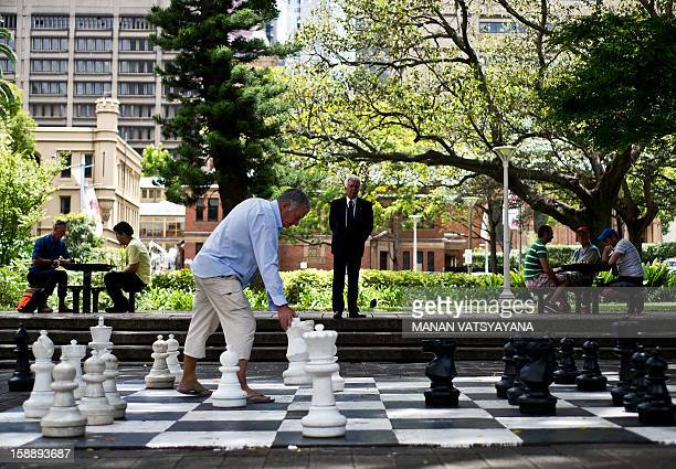 Residents play a game of chess on a giant chessboard in Sydney's Hyde Park on January 3 2013 Spread over 40 acres in Sydney's central business...
