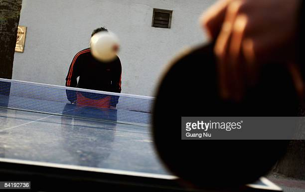 Residents play Ping Pong at an outdoor public sports center on January 7, 2009 in Beijing, China. Ping Pong is the national sport in China and shares...