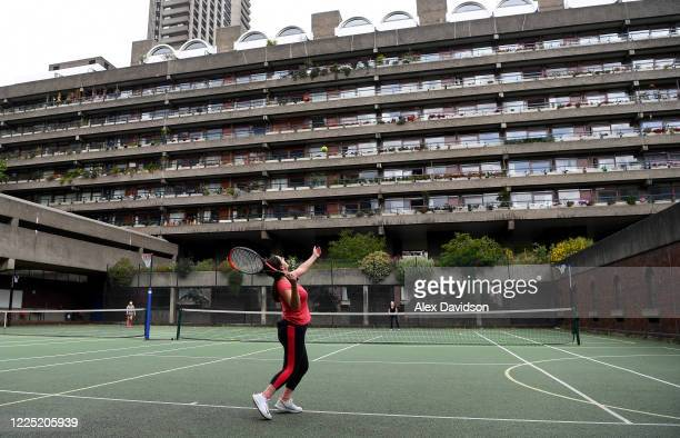 Residents play tennis on the Barbican estate courts May 16 2020 in London England The prime minister announced the general contours of a phased exit...