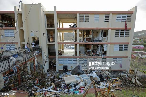 Residents' possessions are shredded and scattered outside the Tutu High Rise more than a week after Hurricane Irma destroyed the building September...