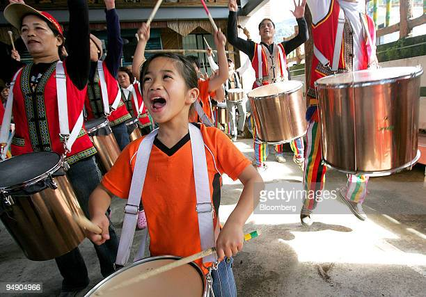 Residents practice on sampa drums prior to a parade in Talampo, Hualien county, Taiwan, on Saturday, Jan. 19, 2008. The Amis tribe, members of the...