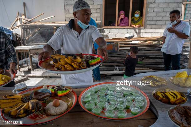Residents prepare a variety of food for the new boat salvation ritual in Pantoloan Boya Village, Palu City, Central Sulawesi Province, Indonesia on...