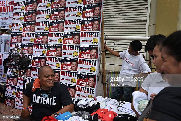 Residents printing Duterte Tshirts at a street on May 8 2016 in Davao City Mindanao Philippines A city of nearly two million Davao is a diverse city...