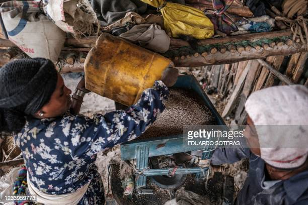 Residents process sorghum in a mill in a rural area near the village of Dabat, 70 kilometres northeast from the city of Gondar, Ethiopia, on July 13,...