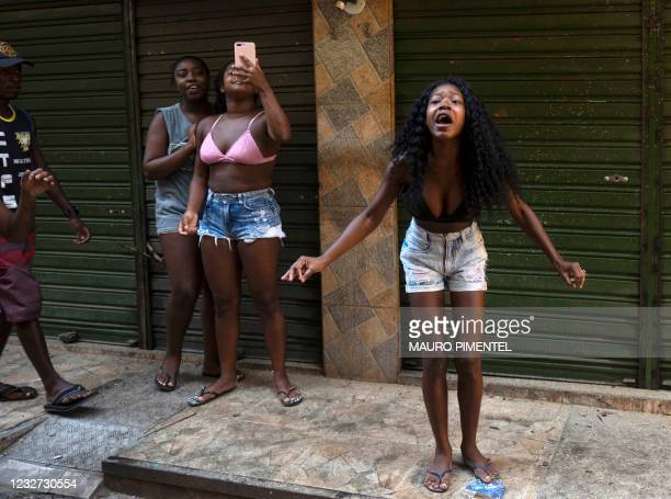 Residents protest after a police operation against alleged drug traffickers at the Jacarezinho favela in Rio de Janeiro, Brazil, on May 06, 2021. - A...