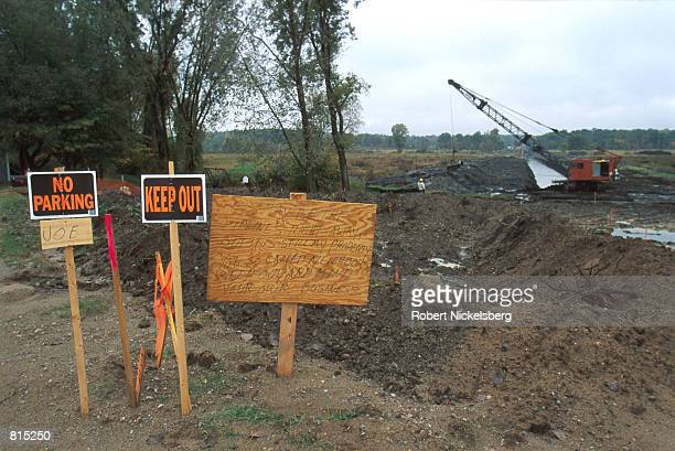 Residents put up protest signs near a pipelaying site October 3 2000 in Howell Michigan 60 miles north of Detroit The pipeline will carry natural gas...