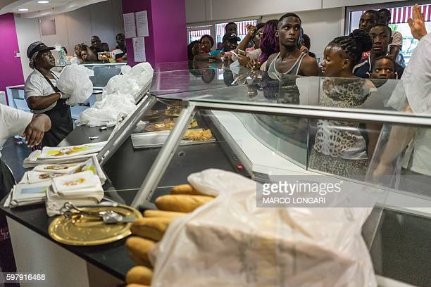 Residents queue at a bakery in the center of Libreville on August 30 2016 as they rush to stock up on bread fearing unrest when the official results...