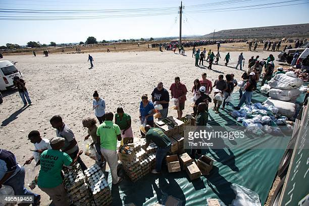 Residents queue for food parcels at Thembelani Mine on June 2 2014 in Rustenburg South Africa Gift of the Givers handed out food parcels to families...