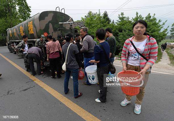 Residents queue for water from a military tanker after a magnitude 70 earthquake hit Lushan Sichuan Province on April 21 2013 More than 150 people...