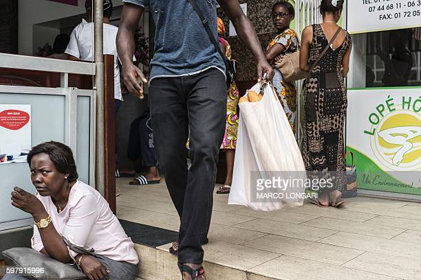 TOPSHOT Residents queue outside a bakery in the center of Libreville on August 30 2016 while rushing to stock up on bread fearing unrest when the...