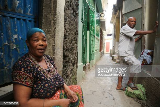 Residents react as Comoros Armed forces members search and patrol the 'Medina' for weapons and armed men at Mutsamudu on October 20 2018 on the...