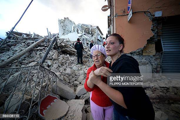 TOPSHOT Residents reacts among the rubble after a strong earthquake hit Amatrice on August 24 2016 Central Italy was struck by a powerful 62magnitude...