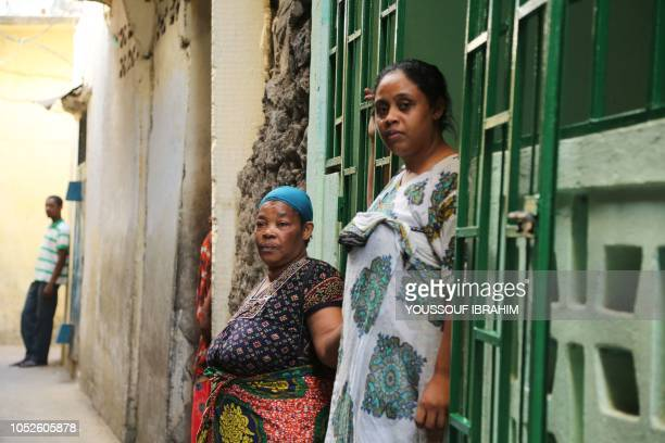 Residents reacts as Comoros Armed forces members search and patrol the Medina for weapons and armed men at Mutsamudu on October 20 2018 on the island...