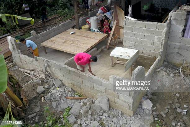 Residents reconstruct their destroyed house after a large earthquake that hit Surigao City in southern island of Mindanao on July 15 2019 Fiftyone...