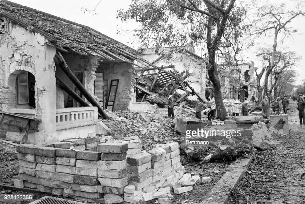 Residents refugees and soldiers file through the messy ruins of a street in Hue The crowd came to inspect the damage after South Vietnamese troops...