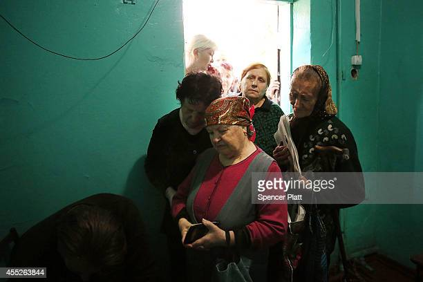 Residents register for assistance in an area that has witnessed heavy fighting on September 11 2014 in Donetsk Ukraine Despite a declared ceasefire...