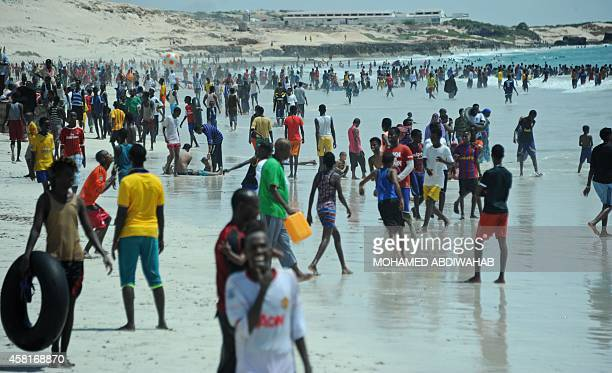 Residents relax on Lido beach on October 31 2014 along the Indian Ocean's coastal city of Mogadishu Lido Beach has become a popular spot over the...