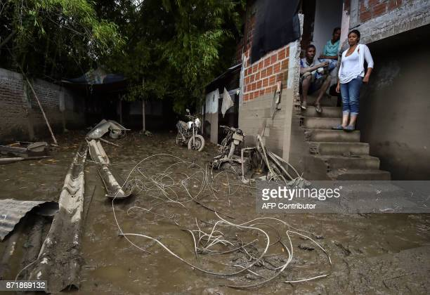Residents remain at their doorstep after a mudslide due to heavy rains affected Corinto in Cauca department southwest Colombia on November 8 2017 The...