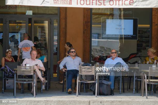 Residents rest in the shade with airconditioned for protection from the heat on June 23 2017 in Bologna Italy An intense heatwave is sweeping across...