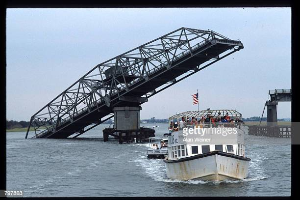 Residents return to the Isle of Palms via ferry because the Ben Sawyer bridge fell into the water September 27 1989 in South Carolina Hugo is ranked...
