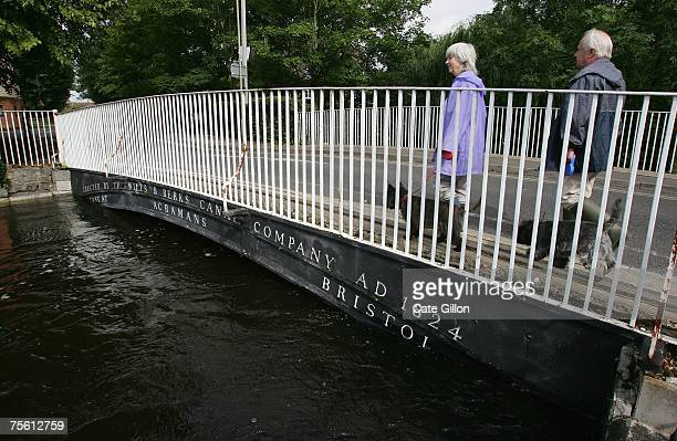 Residents review the damage close to where the Rivers Ock and Thames meet on July 24 2007 in Abingdon England The flooding crisis in central England...