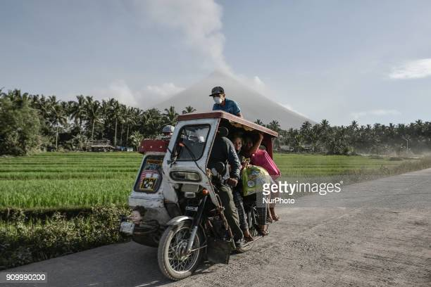 Residents ride a motorcycle as they flee Mount Mayon in Guinobatan Albay province Philippines January 23 2018 Mount Mayon the Philipines' most active...