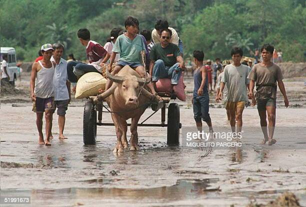 Residents ride an oxdriven cart evacuating the village of Surallah in thesouthern Philippines 12 September A lake on the rim of volcano Parker...