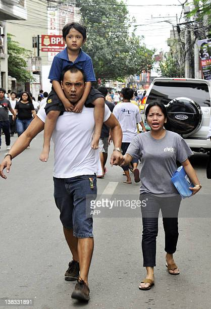 Residents run as they scamper to safety after a 68 earthquake that hit Cebu City on February 6 2012 A 68 earthquake struck off the coast of the...