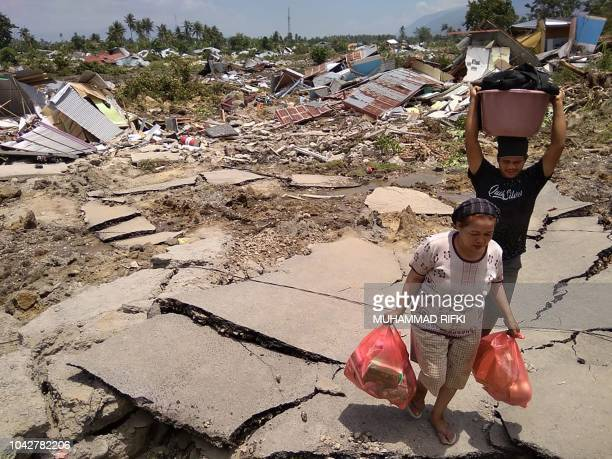 TOPSHOT Residents salvage belongings after an earthquake and tsunami hit Palu on Sulawesi island on September 29 2018 Nearly 400 people were killed...