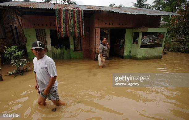 Residents save themselves from floods at Pangkalan village on February 09 2016 in Lima Puluh Koto regency West Sumatra Province Indonesia More 1000...