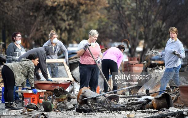 Residents search for an engagement ring at a burned residence in Santa Rosa California on October 20 2017 Residents are being allowed to return to...