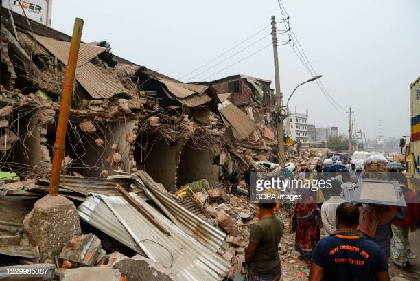 Residents search for their belongings from their demolished house. Bangladesh Inland Water Transport Authority conducts a drive to evict illegal...