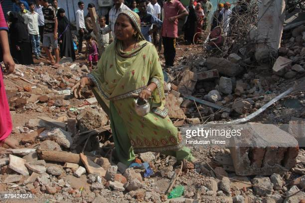 Residents searching their belongings a day after building collapse at Nai Basti Bhiwandi on November 25 2017 in Mumbai India Three people were killed...