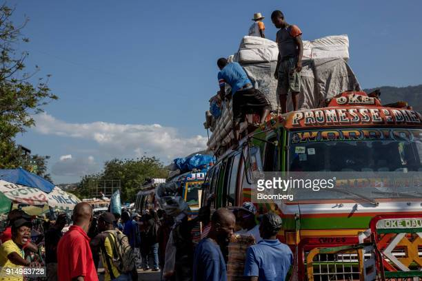 Residents secure items on the top of a public bus known as a Tap Tap in PortAuPrince Haiti on Wednesday Jan 31 2018 Billions of aid poured in from...