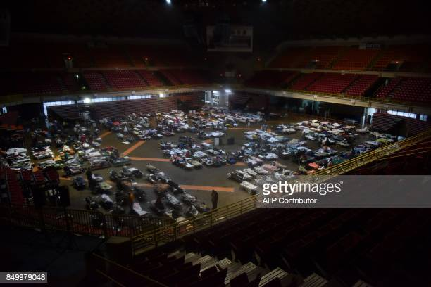 Residents seek shelter inside Roberto Clemente Coliseum in San Juan Puerto Rico early on September 20 as Hurricane Maria passes the island Hurricane...