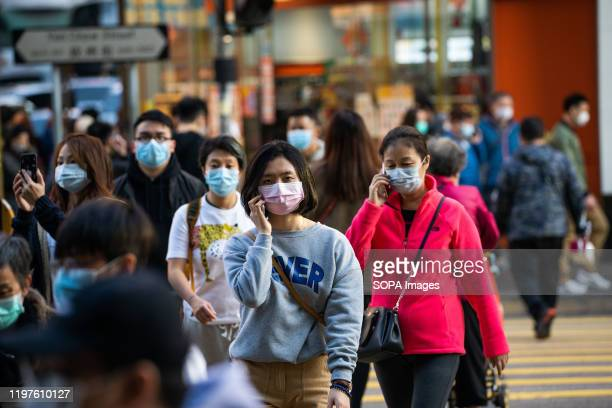 Residents seen wearing surgical masks while crossing the road in order to prevent the spread of the Wuhan corona virus The World Health Organization...