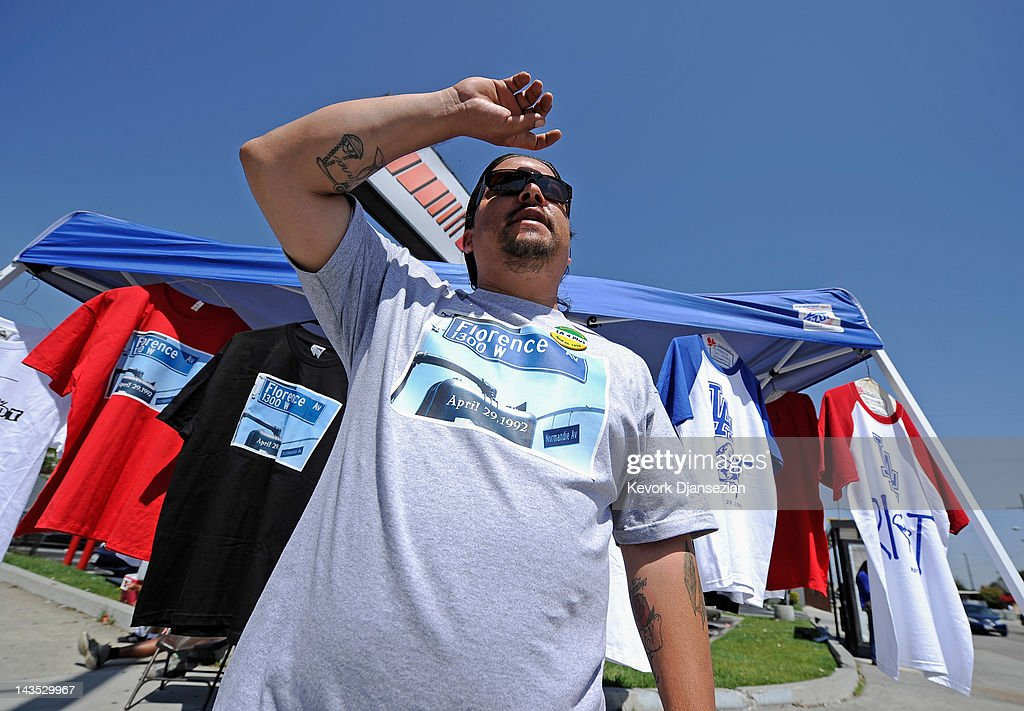 A residents sells shirts commemorating the Los Angeles riots at the intersection of Florence and Normandie Avenues on April 28, 2012 in Los Angeles, California. This intersection was the location of the beating of truck driver Reginald Denny on April 29, 1992, during the early stages of the Los Angeles riots. It's been 20 years since the Rodney King verdict sparked the infamous Los Angeles riots.