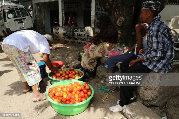 Residents shop for food in Mutsamudu the capital of the Comoros archipelago island of Anjouan on October 20 2018 The Comoros government and main...