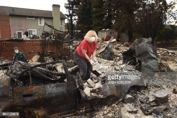 Residents sift through burned out remains at a property in Santa Rosa California on October 20 2017 Residents are being allowed to return to their...