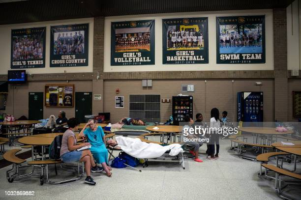 Residents sit at a temporary Red Cross shelter at Conway High School in Conway South Carolina US on Thursday Sept 13 2018 Hurricane Florence's track...