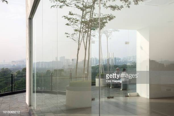 Residents sit in a private condominium opposite the Bandar Malaysia site one of the 1MDB projects on July 29 2018 in Kuala Lumpur Malaysia The...