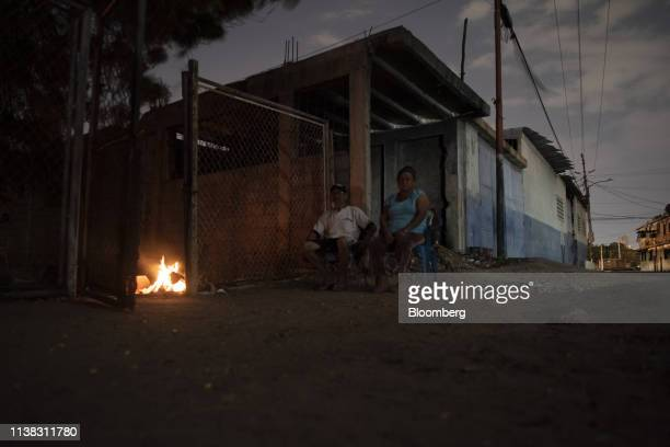Residents sit outside due to high temperatures during a power outage in Maracaibo Zulia state Venezuela on Tuesday April 16 2019 Maracaibo residents...