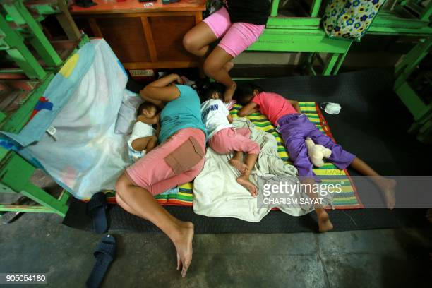 Residents sleep at a temporary shelter after being evacuated from their homes due to Mayon volcano's eruption in Camalig town Albay province south of...