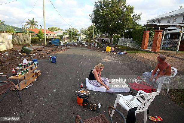 Residents sleep in their street to prevent looters as parts of southern Queensland experiences record flooding in the wake of Tropical Cyclone Oswald...