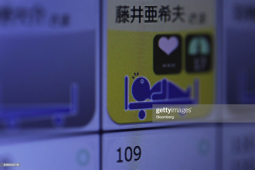 A resident's sleeping condition is displayed on the 'EGAO link' system on an Apple Inc. iPhone in an arranged photograph at the As Partners Co.'s Asheim Nerima Garden nursing home in Tokyo, Japan, on Friday, Aug. 18, 2017. Caregivers can monitor the health of dozens of residents at a time from smartphones, receiving notifications if anyone so much as sits up in bed. Photographer: Kiyoshi Ota/Bloomberg via Getty Images