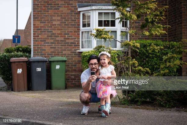 Residents socially distance as they stand outside their homes to sing ahead of the beginning of Passover on April 08 2020 in London United Kingdom...