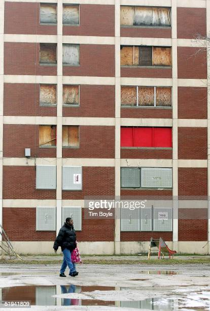 Residents Sonya Swan and her nineyearold daughter Quesha Miller walk past one of the few remaining Chicago Housing Authority CabriniGreen public...