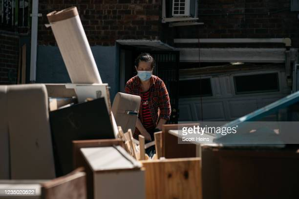 Residents sort through damaged and destroyed items after a night of heavy rain and wind caused many homes to flood on September 2, 2021 in the...