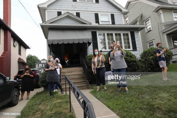 Residents stand in front of the presumptive Democratic presidential nominee Joe Biden's childhood home on July 09, 2020 in Scranton, Pennsylvania....
