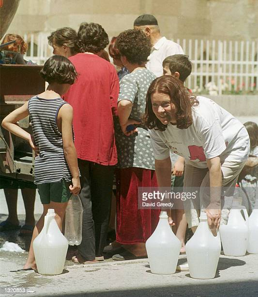 Residents stand in line to fill containers with water from tanker trucks June 9 2001 in Kumanovo Macedonia on the fourth day that this city of 80000...